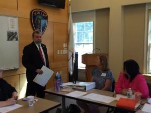 Carmine speaking at Sudbury and Wayland Domestic Violence Roundtable